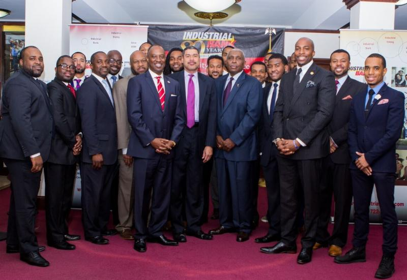 USBC CEO Ron Busby Sr. (center left, red tie), with Industrial Bank CEO Doyle Mitchell along with members of the Black Male Entrepreneurship Institute.