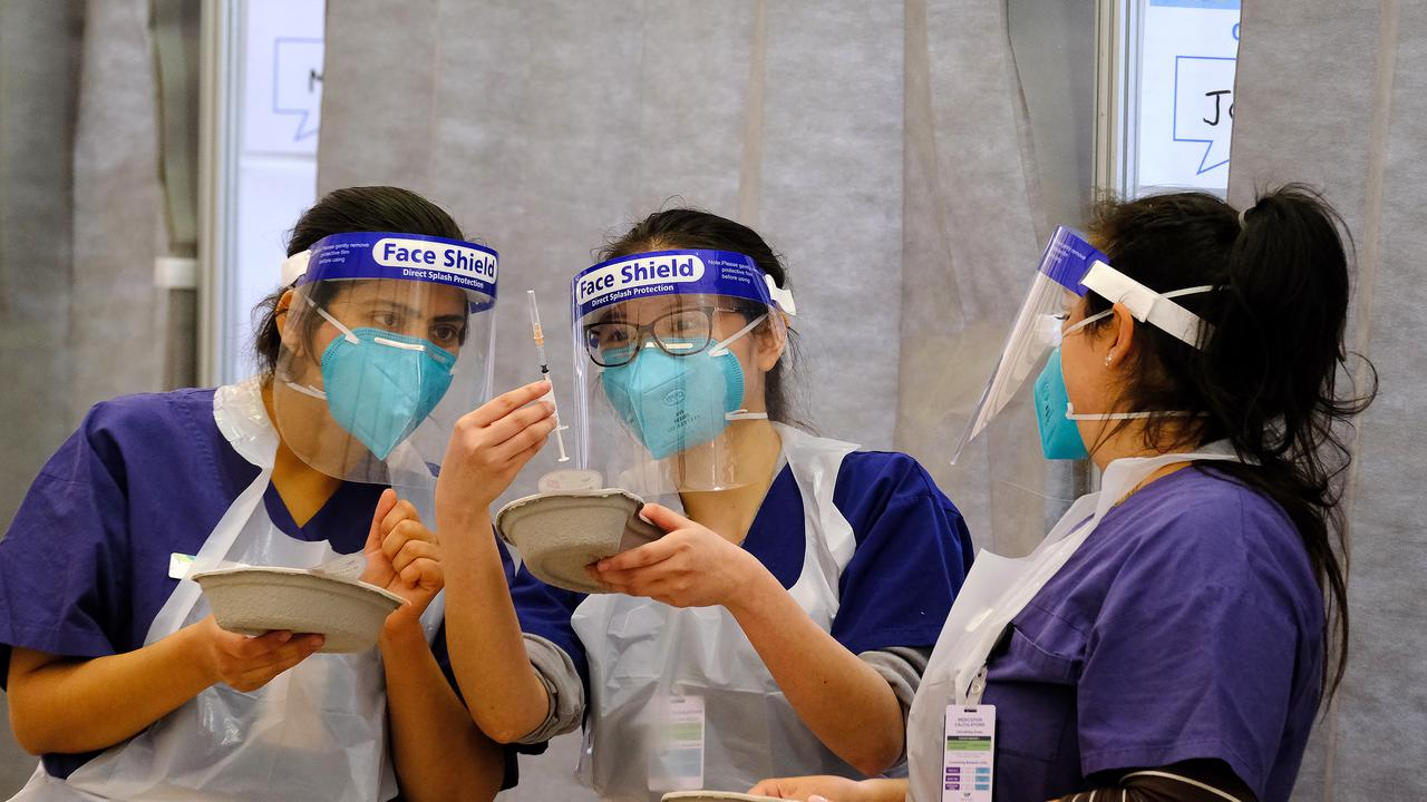 Nursing staff at the mass vaccination hub at Western Health - Melbourne Showgrounds in Ascot Vale.