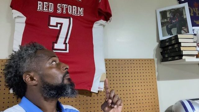 """Darryl Smith's memorial No. 7 football jersey hangs in Dante Jones' garage. """"The loss of Daryl really made me... focus more on trying to save the lives of inner-city kids,"""" Jones said. (Courtesy of Dante Jones)"""