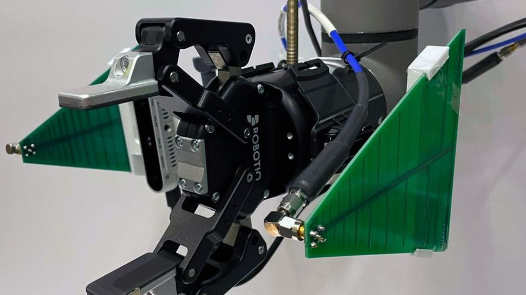 Researchers at MIT have developed a robotic arm that uses visual data from a camera and radio frequency (RF) information from an antenna to find and retrieve objects, even when they are buried under a pile and fully out of view. (Fadel Adib, Tara Boroushaki, et. al.)