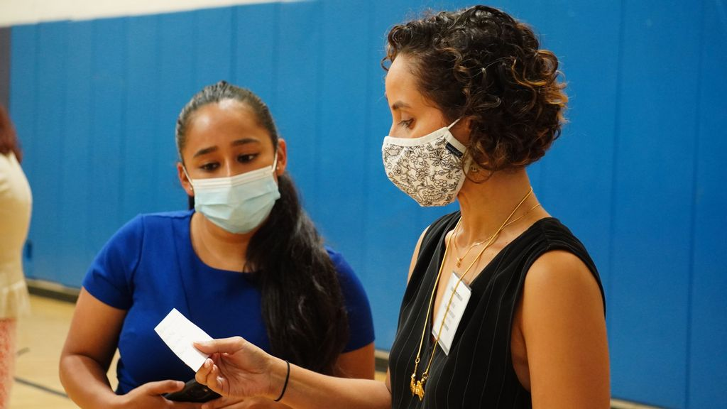 Racial Justice Commissioner Yesenia Mata, left, and Executive Director Anusha Venkataraman talk during a recent session to hear concerns from the public. (Courtesy of New Yoork City Racial Justice Commission).