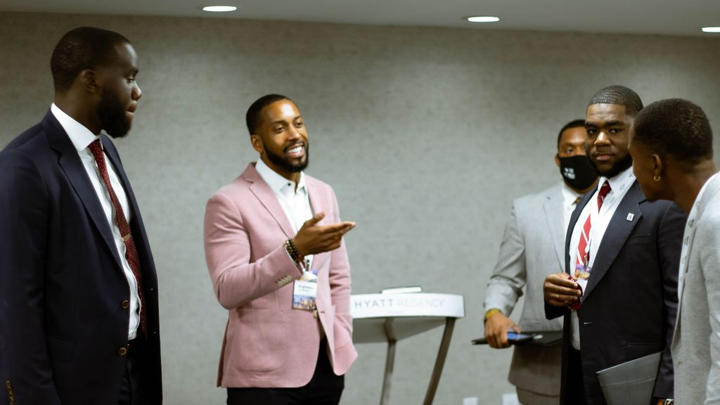 Marvel Joseph (left) and Johnathan Quarles encourage students to appreciate future relations with Israel, at a summit organized by the Maccabee Task Force in Atlanta. (Christopher François)